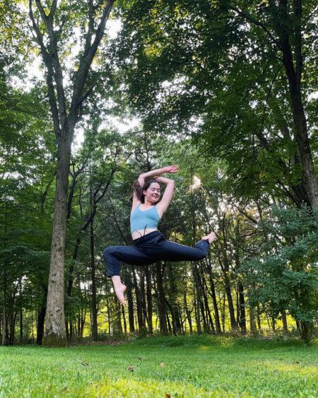 A dancer jumps outdoors